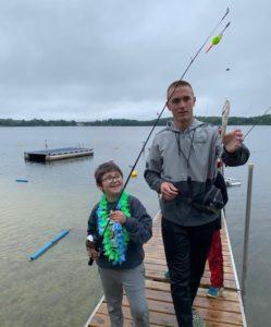 Kid fishing with staff
